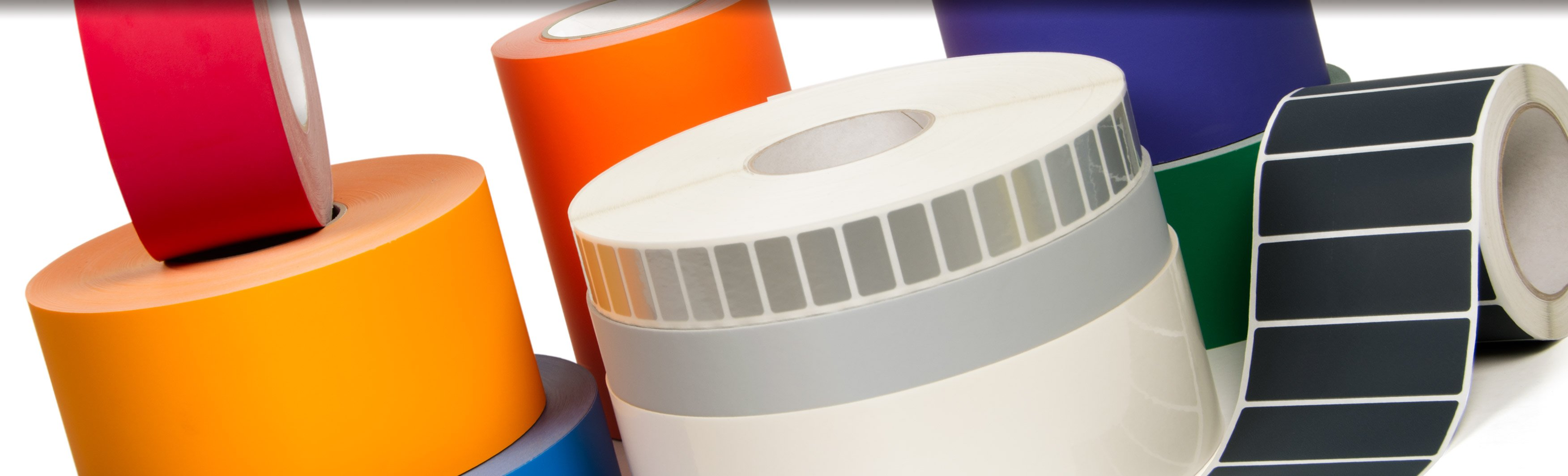 A huge amount of tape and label material in jumbo rolls for the label converter